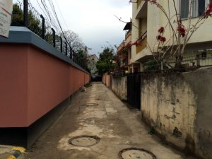 The long narrow alley leading to the gate of Goshen House.