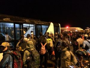 Travelers loading on to a shuttle bus to their flight.